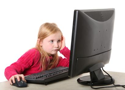 girl looking at computor monitor